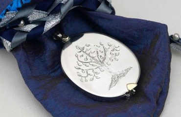 white-gold-locket with cameo portrait on-satin