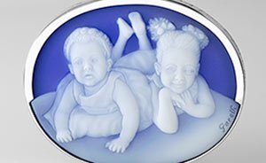 Cameo of two girls in white gold