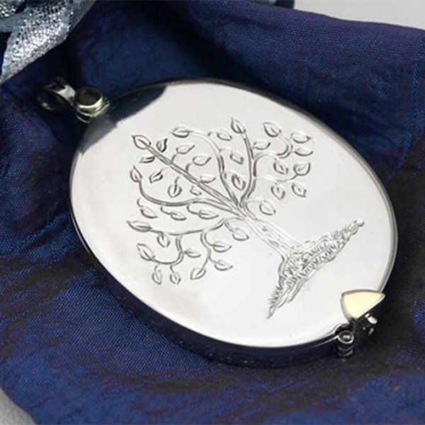 white-gold-sympathy-locket-on-satin-sq